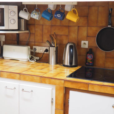 Kitchen with gas cooktop and microwave